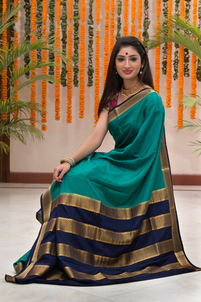 Turqouise Blue Pure Crepe Silk Saree With Zari On Border