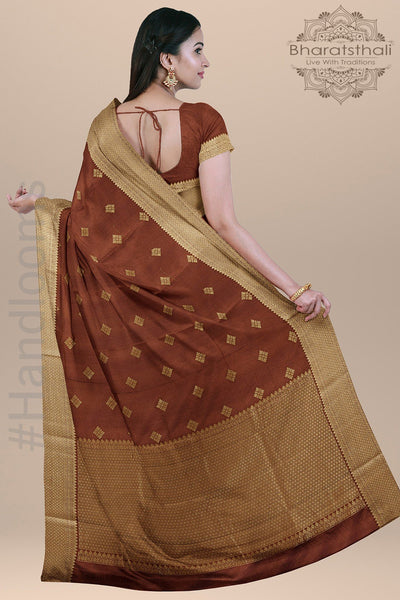 Seinna Brown Color Silk Saree with all over Booty and Golden Zari pallu