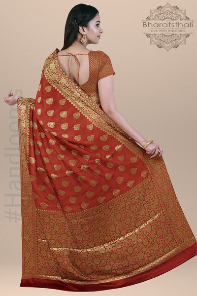 Dark Orange Color Silk Saree with all over Booties and Heavy Zari pallu