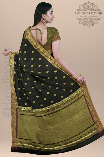 Black  Color Silk Saree with  all over small Golden Booties and  Golden Zari pallu