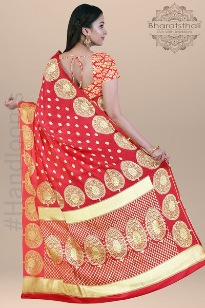 Dark Peach Color with Small Round Zari Booties and Heavy pallu