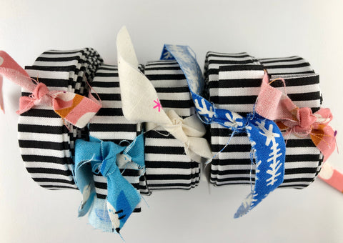 rolls of black and white quilt binding with fabric ties
