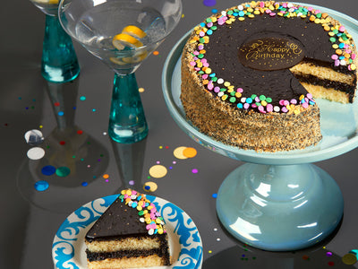 Celebrate your loved ones in style with yummy yellow cake and rich fudge frosting with rainbow candies!