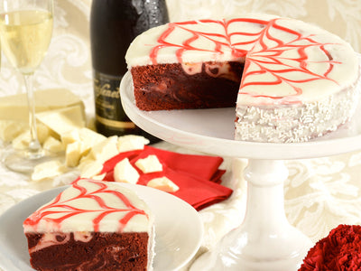Rich, marbled, red velvet brownie cake is covered by a sophisticated and delicious icing.