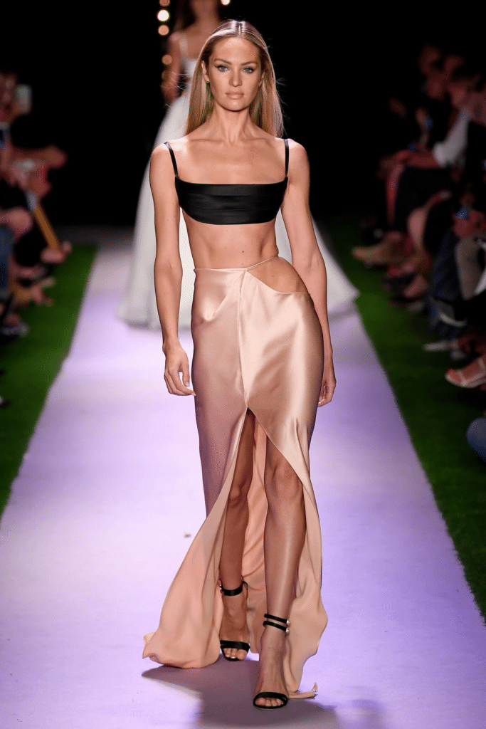 A backstroke swimmer is compared to a model walk in runway