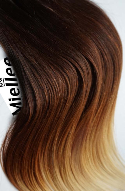 High Contrast Golden Ombre Seamless Tape Ins - Wavy Hair