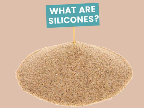 pile of sand with what are silicones written.
