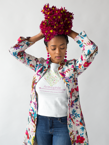 a woman wearing flower jacket and flowers on her head is an anthophile