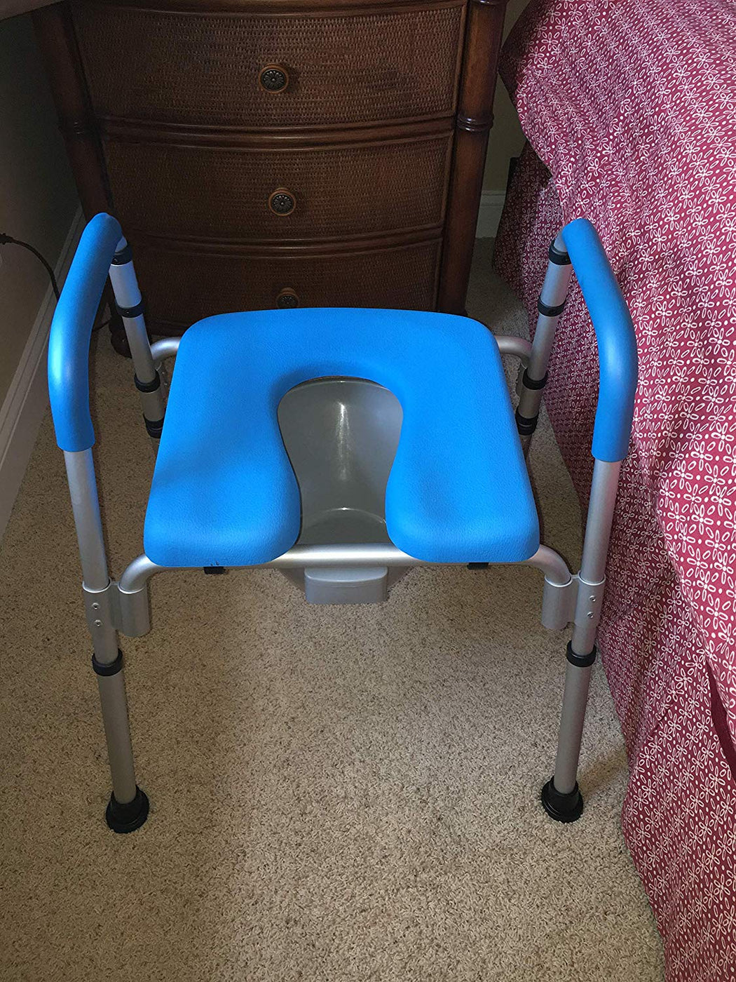 a raised toilet seat, a bedside commode and as a shower chair