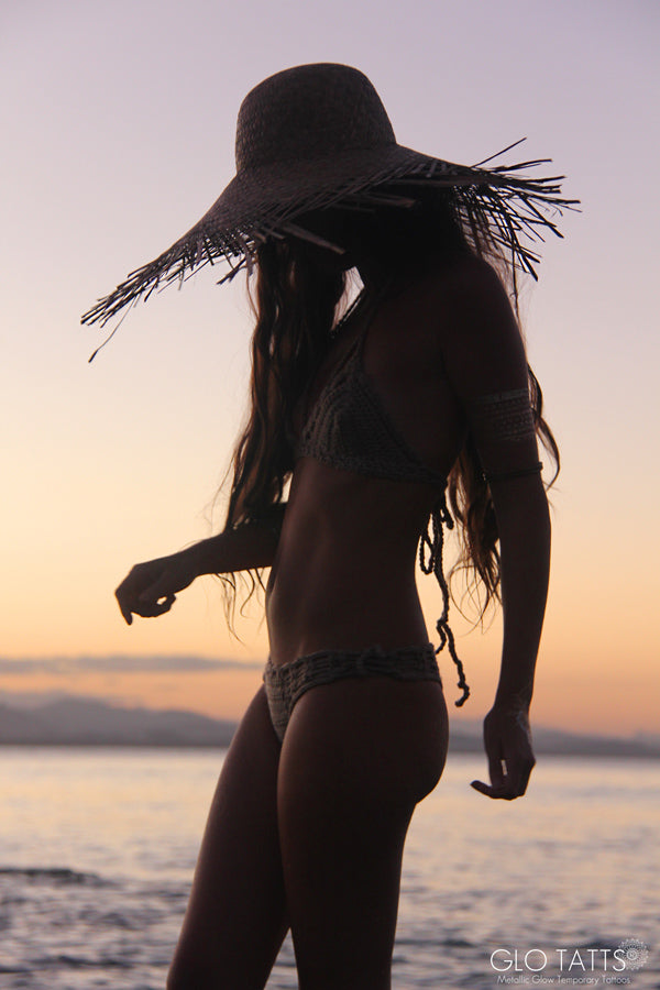 GLO TATTS flash tattoo lack of color straw hat crochet bikini Byron Bay sunset
