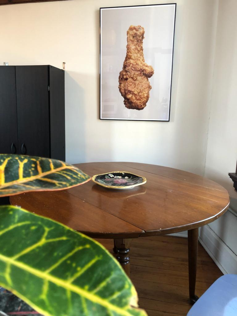 Hanged photograph of chicken in front of dining table. Photo given courtesy by the collector.