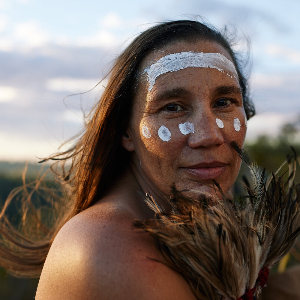 First Nations Woman with traditional face paint