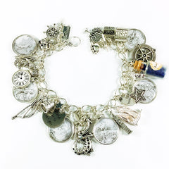 Peter Pan charm bracelet with vintage black and white cameos