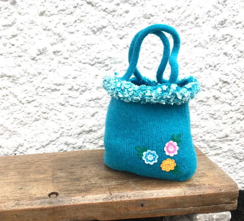 Blue felted bag with frosted trim and flowers