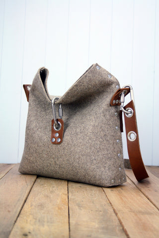 Fold over top handbag