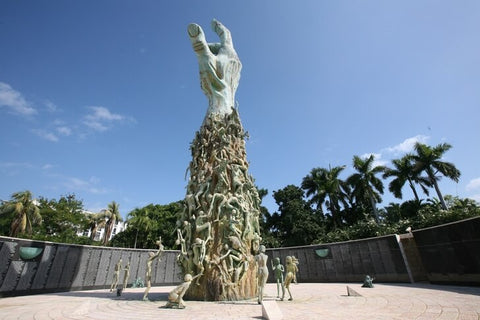 The memorial is made in the form of an arm stretched to the sky, on which upward are climbing emaciated human figures with the prints of horrific suffering on their faces.