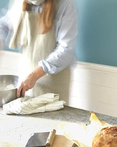 photo of blurry person cooking with silver pot