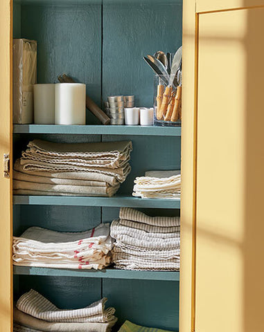 painted blue shelf with towels