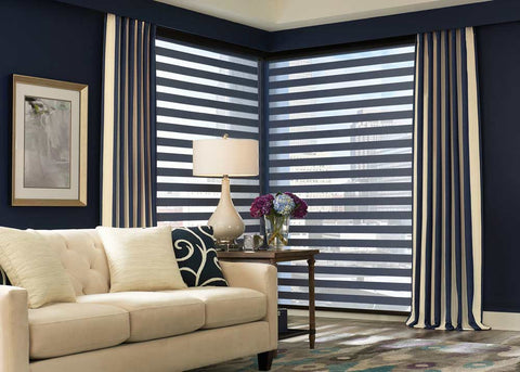 living room with navy walls drapes and white shutters
