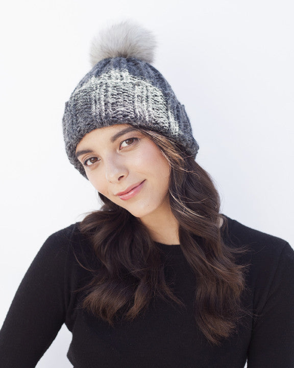 charcoal knit hat with fur pompom