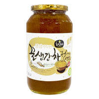 Honey Ginger tea in a large glass jar with real ginger pieces
