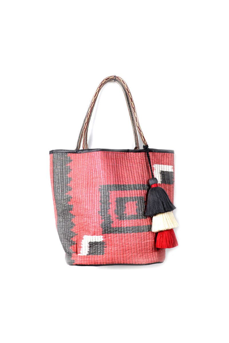 Quilted Ikat Bag with Pom-Poms