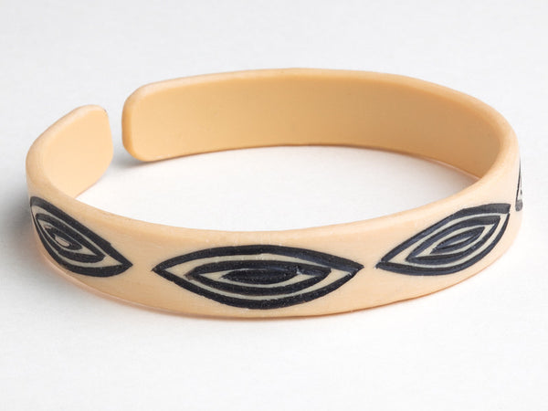 Epatek Bangle with etched eye pattern