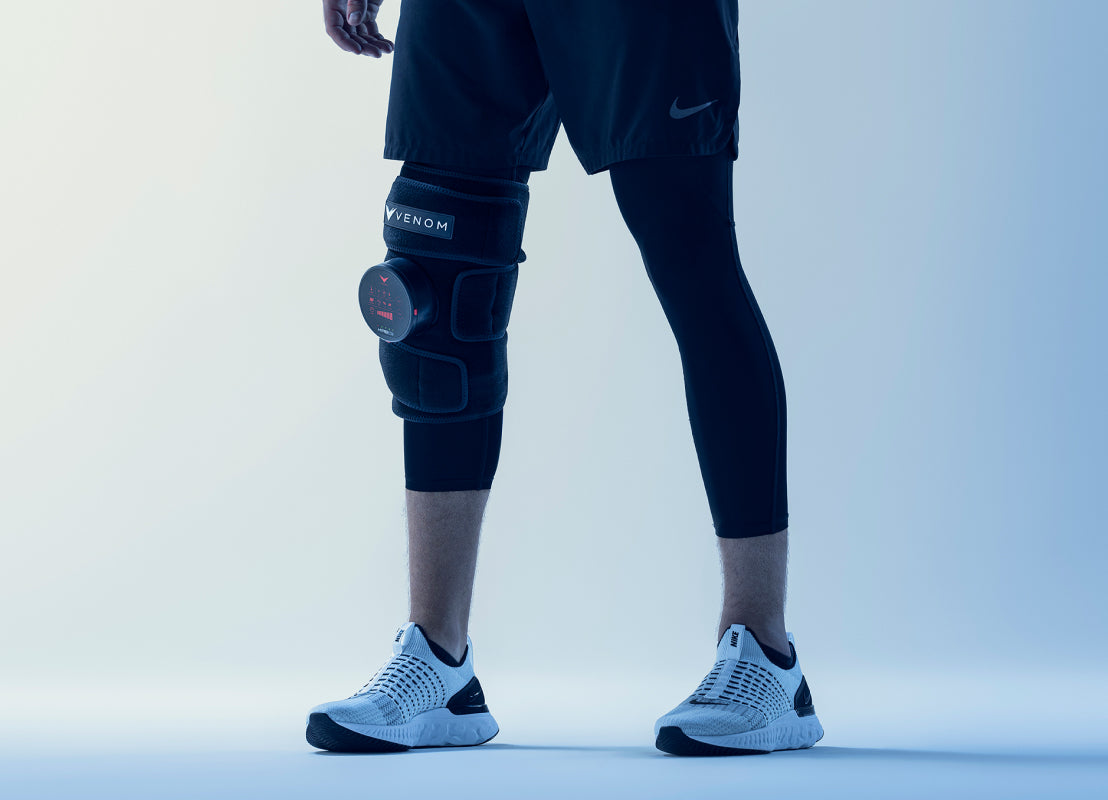 a person shown from the waist down with black shorts and black leggings with the black venon on their right knee