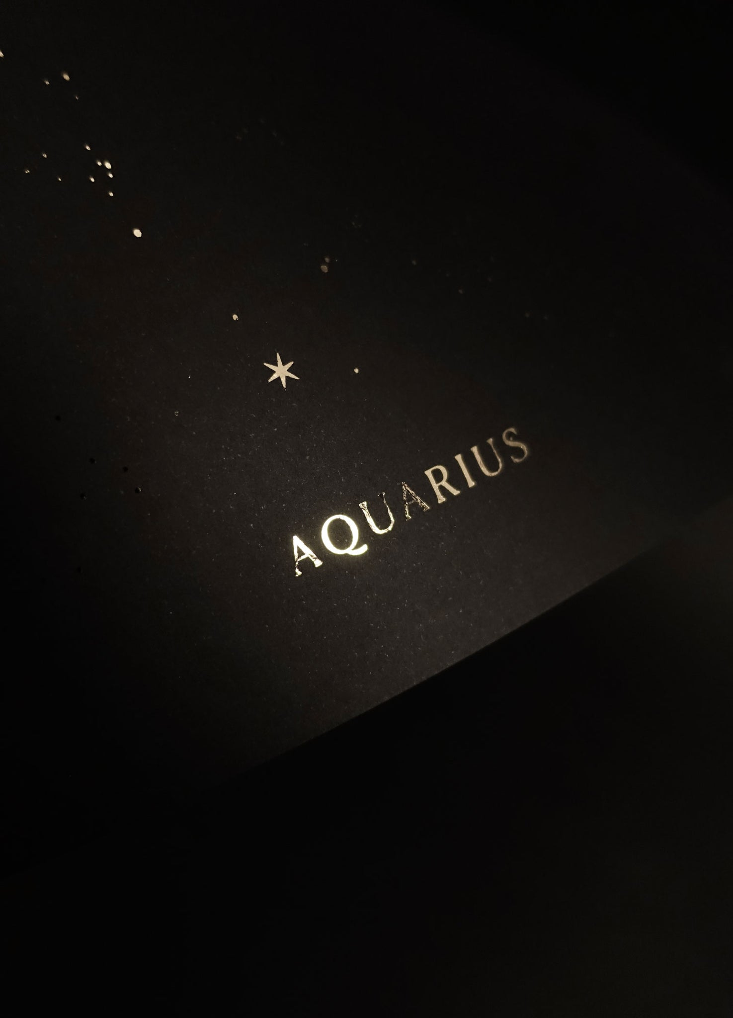 Aquarius zodiac constellation gold metallic foil print on black paper by Cocorrina