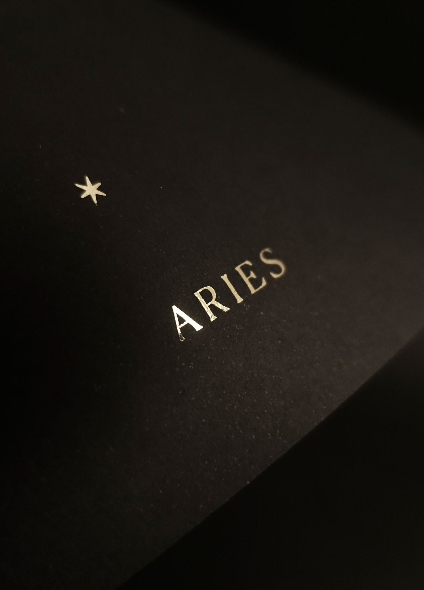 Aries zodiac constellation gold metallic foil print on black paper by Cocorrina