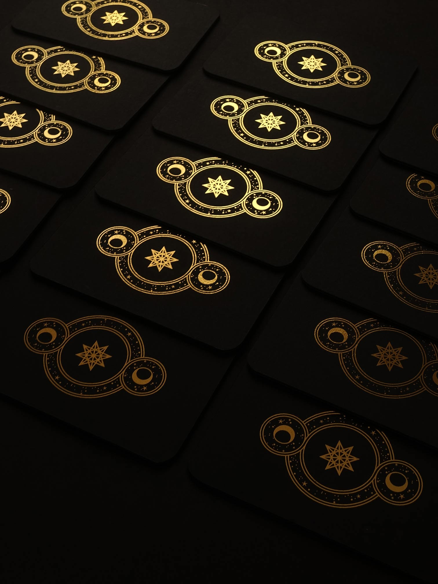 Cosmic Whisper rune deck by Cocorrina & Co in black and gold foil
