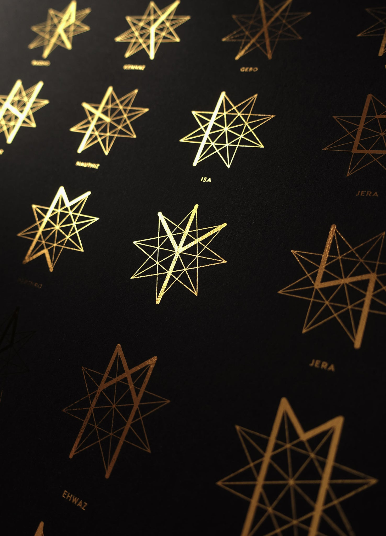 The rune star, set of 24 runes in gold foil black art print by studio Cocorrina design