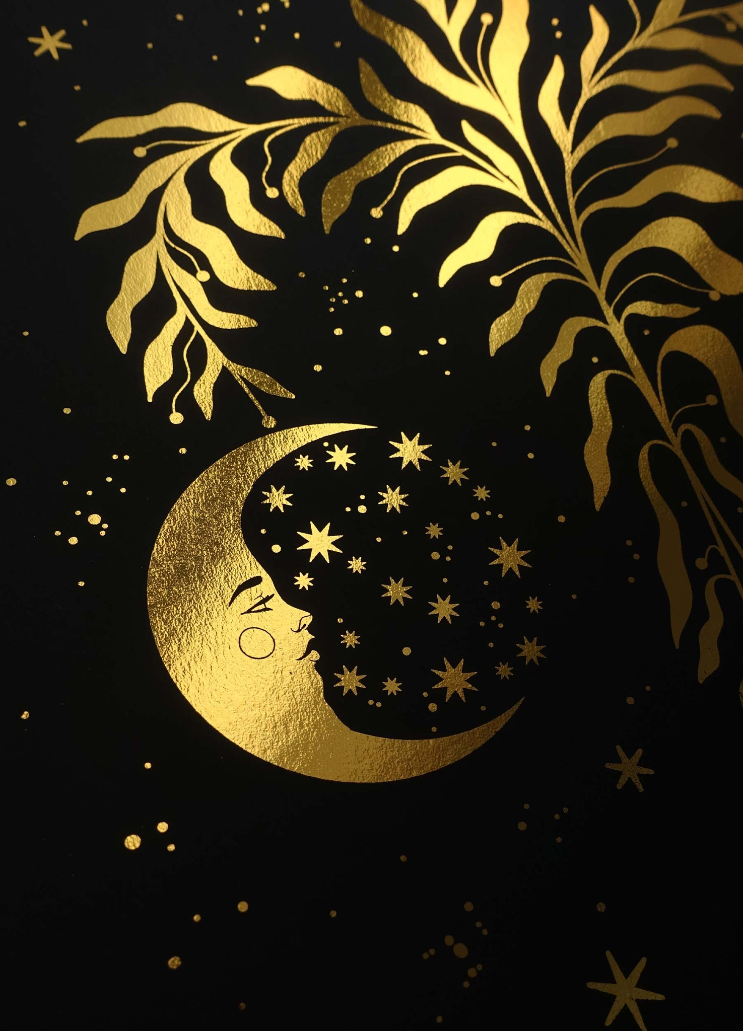 The Yule tree with a sun, moon and star gold foil art print on black paper by Cocorrina & Co