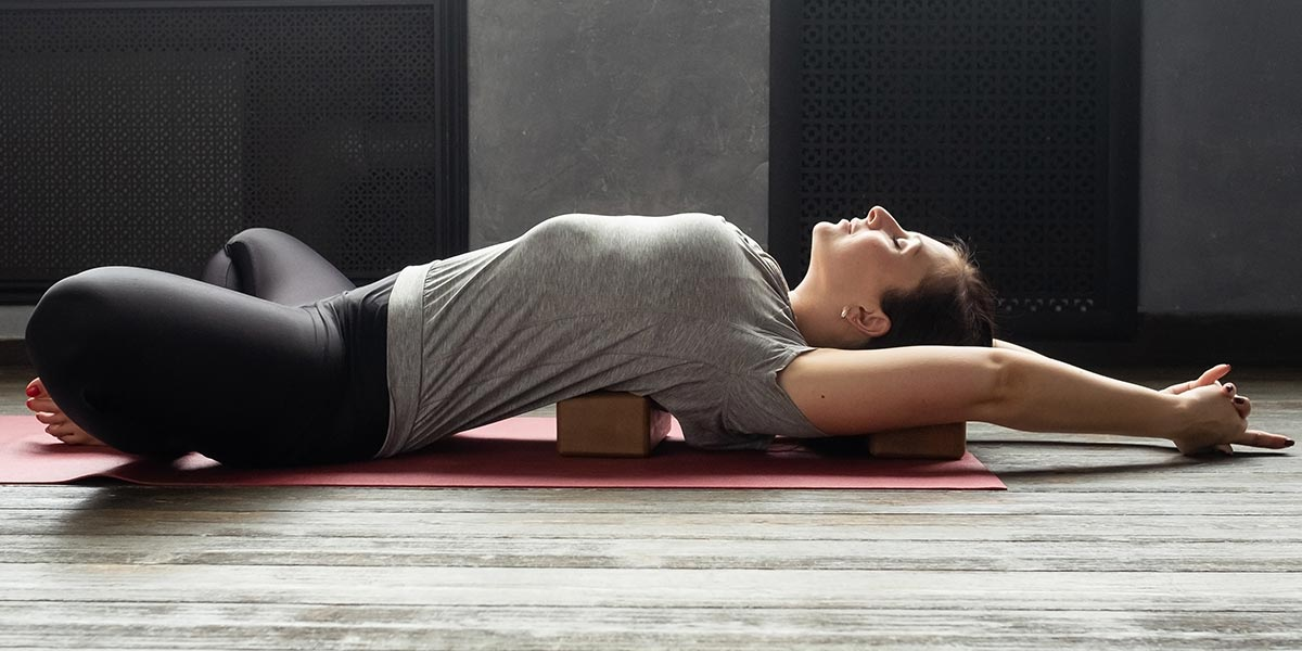 Reclined butterly helps improve sleep quality   Benefits of Yoga by Nutrova