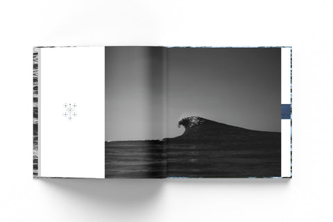 Mockup of an open book with the picture of a breaking wave in dark tones against a white background