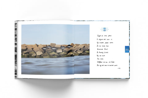 Mockup of an open book with a photograph taken from the sea of a harbour wall a harbour wall