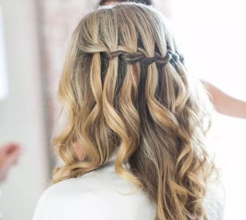 The waterfall braid is one of the classiest hairstyles you can do with your Minque halo hair extensions.