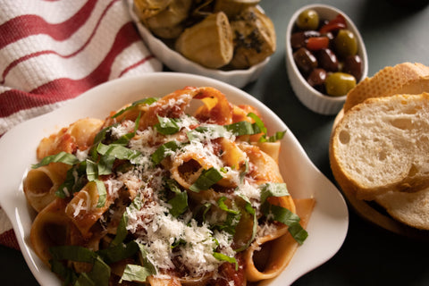 Old classic basil pappardelle pasta with classic tomato sauce by TerraMar Imports. Italian cuisine.