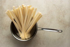Boil the pappardelle pasta in a saucepan.