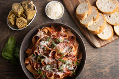 Serve the pasta noodles and add parmigiano cheese as a garnish and taste the traditional flavors of Italy.