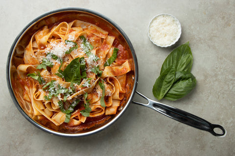 Serve and garnish with grated cheese and basil leaves