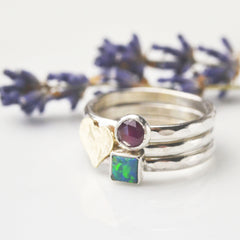 gold heart stacking ring set with dark opal