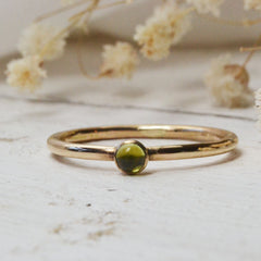 peridot birthstone for august - with gold ring
