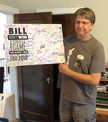Bill Sininger has a sign, signed by everyone who beat him at cards.
