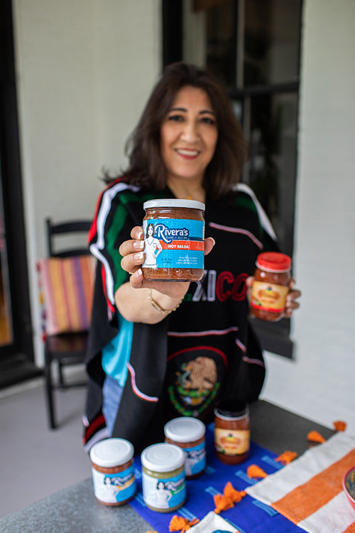 Elia Rivera, Founder and CEO of Rivera's Mexican Foods, showing the new Rivera's Family Recipe Salsa.