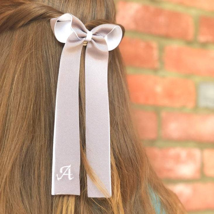 Embroidered initial tails bow