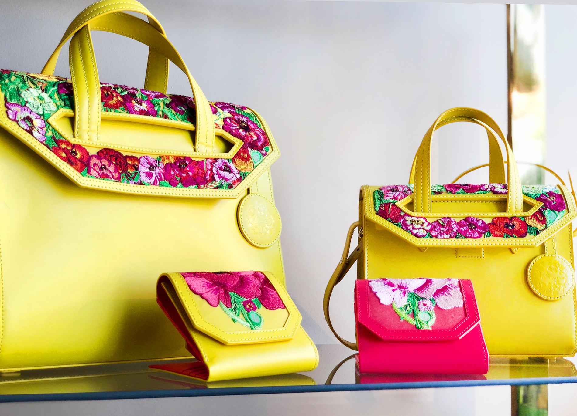 Most gorgeous bags luxurious handbags in yellow, magenta, and beige, hand-embroidered with poppies in exquisite detail. Stunning purse to behold.