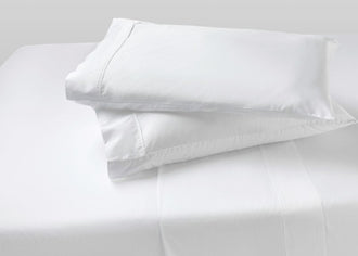 Two agility cool foam pillows stack on top of each other with Bright White pillow sheets