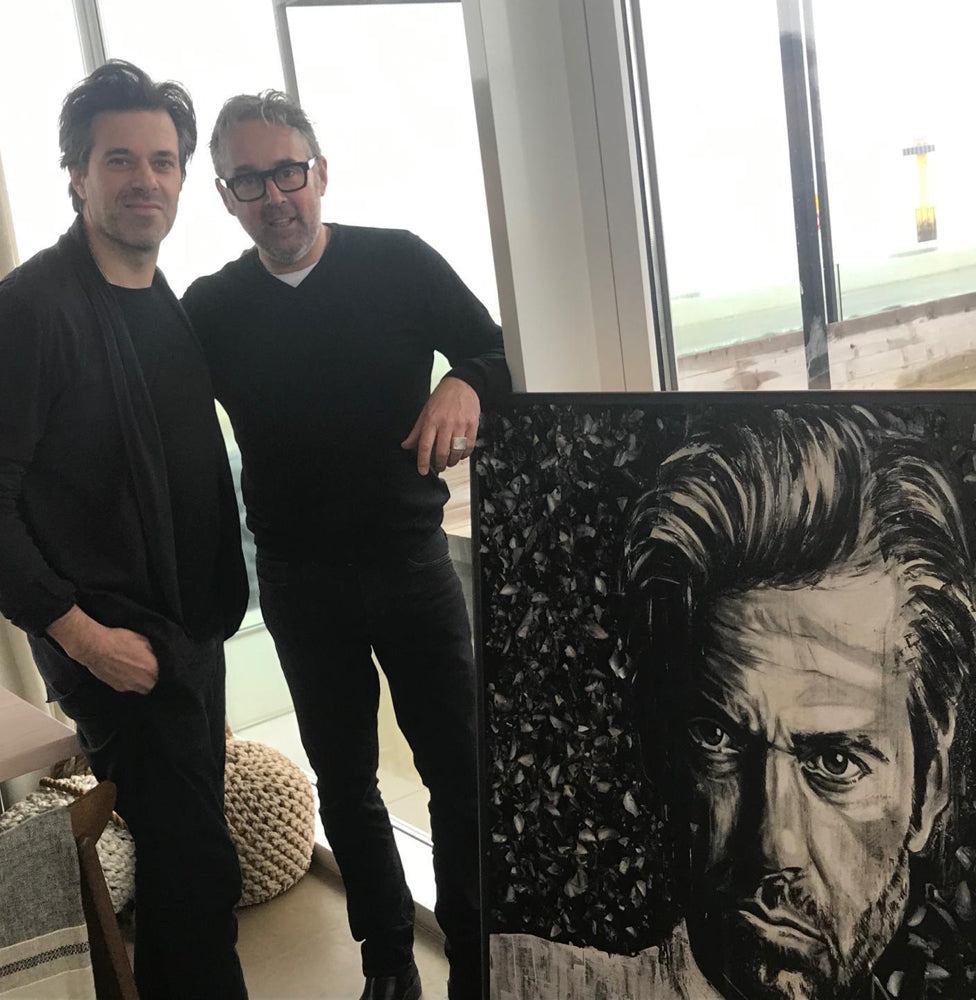 Presenting finished portrait art to chef Sergio Herman