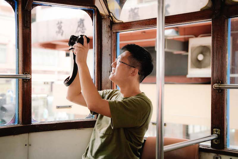 Bamboo Scene Artist Jeremy Cheung Photographing on the tram in Central